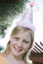 Teenage Girl Wearing Birthday Cap Royalty Free Stock Photography