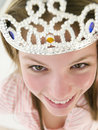Teenage girl wearing crown and smiling Stock Photography