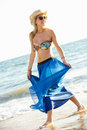 Teenage Girl Wearing Sarong On Beach Holiday Stock Image