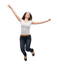Teenage girl in white blank t-shirt jumping Royalty Free Stock Photo