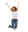 Teenage girl in white blank t shirt jumping activity and happiness concept smiling Stock Photo