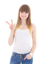 Teenage girl in white t shirt showing victory sign isolated on w background Royalty Free Stock Photos