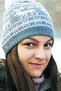 Teenage girl in winter cap portrait of beautiful caucasian gray Stock Photo