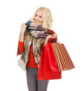 Teenage girl in winter clothes with shopping bags retail and sale concept happy Stock Photography