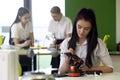Teenage Girl Working on Robotic Arm Royalty Free Stock Photo