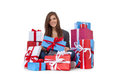 Teenage girl within wrapped presents attractive sitting all on white background Royalty Free Stock Images