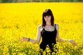 Teenage girl on yellow field Royalty Free Stock Photos