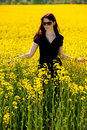 Teenage girl on yellow field Stock Photos