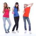 Teenage girls dancing fun to cell phone music Royalty Free Stock Photo