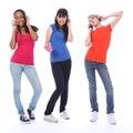 Teenage girls dancing fun to cell phone music Royalty Free Stock Photo