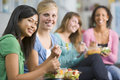 Teenage girls enjoying healthy lunches together Stock Photos