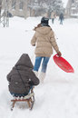 Teenage girls having fun in the deep snow during winter blizzard Royalty Free Stock Photo
