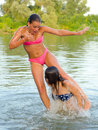 Teenage girls having fun in the river two beautiful on summer day Stock Images