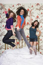 Teenage Girls Jumping On Bed Royalty Free Stock Photo