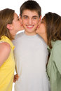 Teenage girls kissing teenage boy Royalty Free Stock Photos