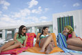Teenage girls lying on sunloungers at resort three Stock Photography