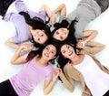 Teenage girls lying on white floor Royalty Free Stock Photo