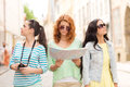 Teenage girls with map and camera Royalty Free Stock Photo