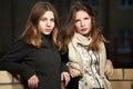 Two fashion teen girls on night city street Royalty Free Stock Photo