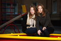 Teenage girls on the playground two young sitting Royalty Free Stock Photo