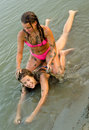 Teenage girls playing on the beach Royalty Free Stock Photo