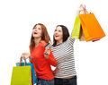 Teenage girls with shopping bags and credit card sale gifts concept two smiling Royalty Free Stock Photos