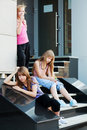 Teenage girls on a steps Royalty Free Stock Photo