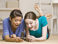 Teenage girls text messaging on cell phone Royalty Free Stock Photo