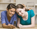 Teenage girls text messaging on cell phone Royalty Free Stock Photos