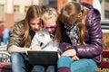 Teenage girls using laptop on the bench schoolgirls Stock Image