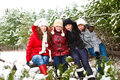 Teenage girls in a winter park hugging joyful Royalty Free Stock Photography