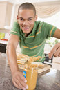 Teenage Male Making Peanut Butter Sandwich Stock Images