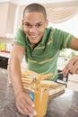 Teenage Male Making Peanut Butter Sandwich Royalty Free Stock Photo