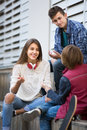 Teenage males and girl talking Royalty Free Stock Photo