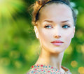 Teenage model spring girl beauty over nature green background Royalty Free Stock Photography