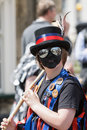 Teenage morris dancer chippenham uk may a with a painted face and wearing mirrored sunglasses performs on the opening day of the Stock Photography
