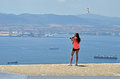 Teenage photographer at gibraltar a girl standing on a wall in with a dslr and telephoto lens Royalty Free Stock Photo