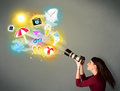 Teenage photographer making photos of holiday painted icons Royalty Free Stock Photo