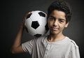 Teenage soccer player portrait of young boy with a ball Stock Images