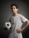 Teenage soccer player portrait of young boy with a ball Royalty Free Stock Image