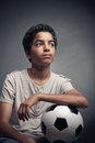 Teenage soccer player portrait of young boy with a ball Royalty Free Stock Photography