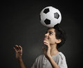 Teenage soccer player portrait of young boy playing with a soccerball Royalty Free Stock Photo