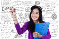 Teenage student makes math formula Royalty Free Stock Photo
