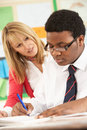 Teenage Student Working In Classroom Royalty Free Stock Photography