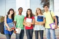 Teenage Students Standing Outside College Building Stock Photography