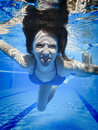 Teenage swimming underwater in the pool Royalty Free Stock Photos