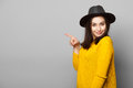 Teenage woman pointing to blank space stylish young her finger towards isolated over grey background Royalty Free Stock Image