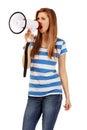 Teenage woman screaming through megaphone Royalty Free Stock Photo