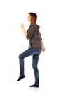 Teenage woman trying to trample something Royalty Free Stock Photo
