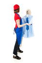 Teenage worker holding mop shirt tie pretending to dance them isolated white Stock Photography